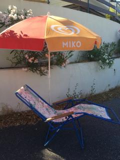 Fully reclining chairs for 'the beach sleep' with parasol to stop the burning.
