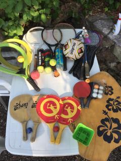 Table tennis bats, tennis raquets (4) skimmer, other beach games.