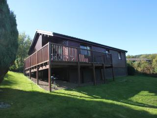 Screel Lodge with large panoramic decking area which looks over 12th fairway of Colvend golf course