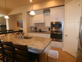 Upgraded gourmet kitchen- granite,stainless steel appliances, fully stocked/lots of dishes for16