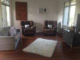 Lazy, comfortable lounge with queen sofa bed, large TV leading onto large balcony/deck.