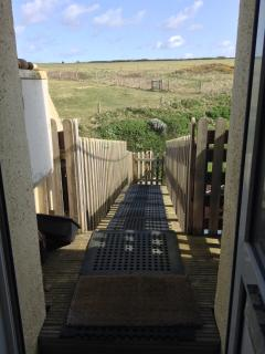 Down the wooden bridge to the Cornish coastal path