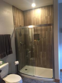 Master suite has private bathroom with large custom tile shower.