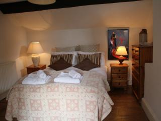 The large double bedroom overlooks the quiet historic village street