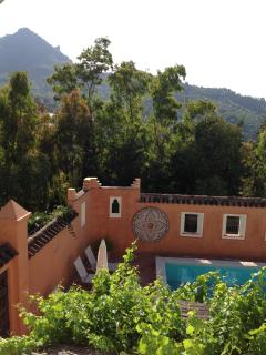 View of local mountain behind the swimming-pool courtyard, El Hacho.