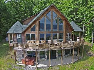 Exquisite 5 Bedroom Log Home with phenomenal lake views!