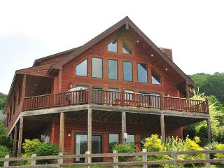 Illustrious 4 bedroom log home located in the heart of McHenry.