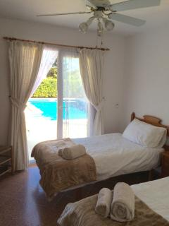 2 Twin bedrooms with direct access to the pool area