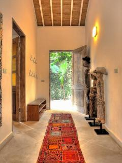 The main entrance to Villa 007 features local artwork.