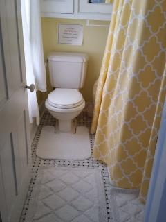 Pretty bathroom; deep clawfoot tub and marble tiled floor