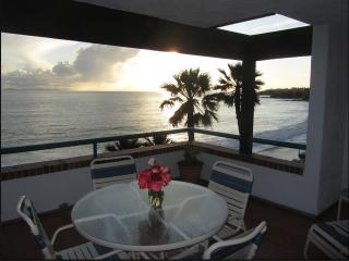 Evening view. All apartments have full-on views facing ocean & beach.Exact view varies by apartment.