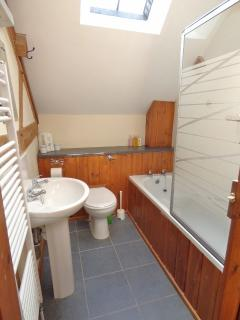 Bathroom with white fittings throughout