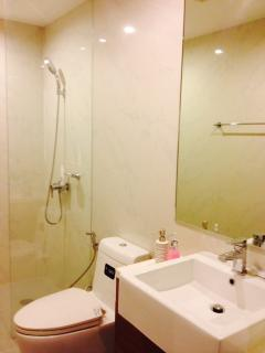 Two toilets with hot rain shower