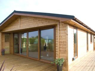 Luxury wooden self catering lodges with Hot Tub., Fitling