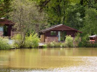 Mumpuss Lodge, located in woodland overlooking a lake