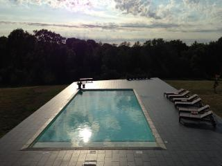 Swimming pool: view from the apartment at sunset.