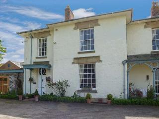 THE OLD RECTORY COTTAGE, woodburner, country views, lawned garden with furniture, in Llandyssil, Ref 926581