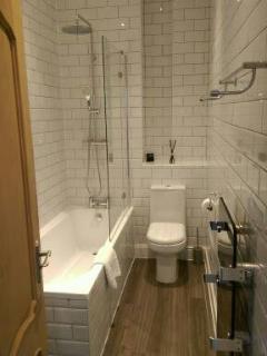 Bathroom with rain shower over the bath