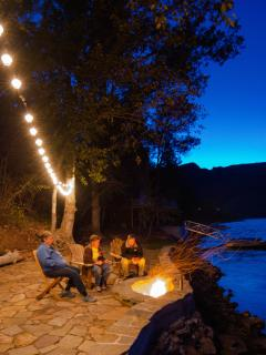 Have a campfire in fire pit on our private lakefront stone patio.  Enjoy smores!
