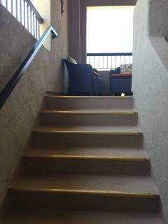 Stairs leading to front balcony outside front door (casual seating & bistro table)