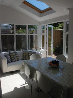 Sitting and dining area leading on to the garden