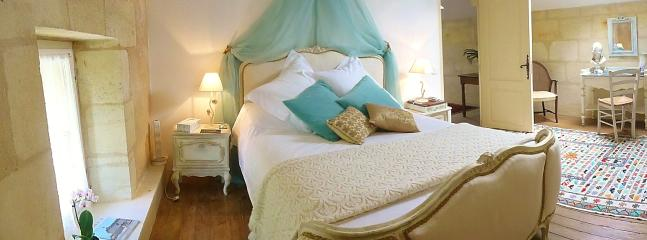 Romantic chambre d'or with Louis XV1 bed, with mattress topper and luxury bed linen.