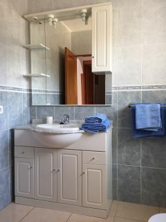 Bathroom - sink, storage cupboards, large mirror