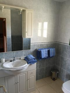 Bathroom with towels provided for guests
