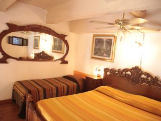 sleeping loft with one king size bed, 2 single beds, ceiling fan and wardrobe