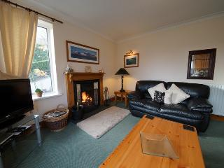 Lounge with open fire - Keswick Cottages