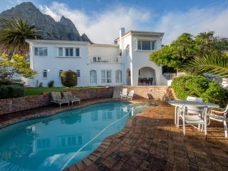 The front of the villa with the pool and entertainment area. backdrop of the twelve apostles