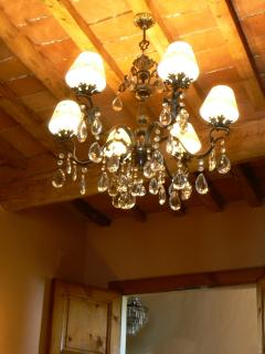Yet another bronze / crystal chandelier illuminates the traditional wood and terracotta ceilings.