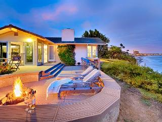 Sweeping whitewater views from this exclusive oceanfront home