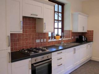 Kitchen with large fridge freezer, washing machine and dishwasher