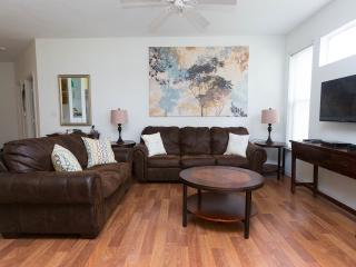 Living Room with large TV with movie streaming and 250 TV channels. Ceiling fan. Air conditioning