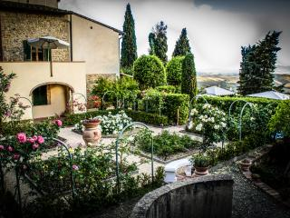 Fabulous farmhouse with gorgeous garden and incredible views of the Siena countryside boasts private pool and terrace