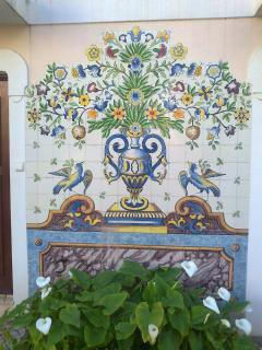 Tile picture on wall in The Old Village