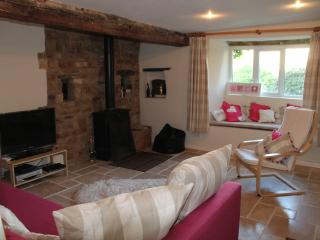The cosy livingroom houses a Multifuel stove and superb bed settee.