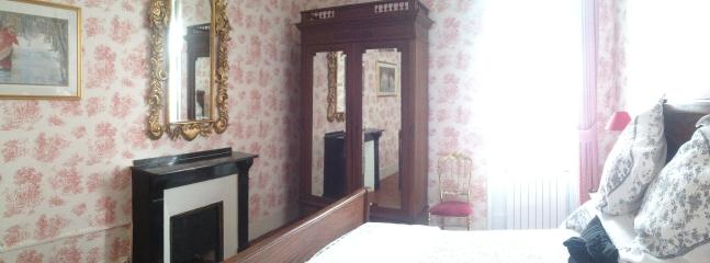 The pretty bedroom with antique furniture