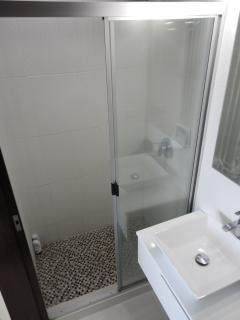 Shower with Full Glass sliding doors not some cheap shower plastic curtain.