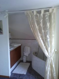 Two of the rooms have a bath