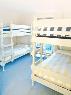 The third bedroom which has 2 double bunks has views to the beach