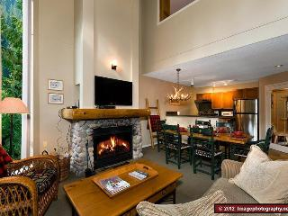 This is the living and dining area and kitchen on the main level. This is a beautifully decorated mountain home with a very friendly and welcoming feeling.