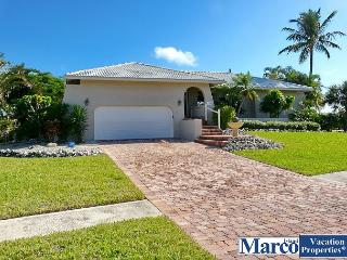 Corner lot waterfront house with huge yard, heated pool and walk to the beach, Marco Island