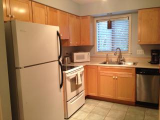 Fully stocked modern kitchen with laundry facilities