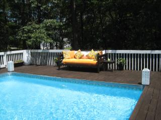 End Summer in this Bright, White 4 Bed with Heated Pool in NW Woods on 2 Acres!