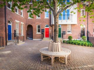Pass through the archway from the high street into the calm of Heritage Court courtyard