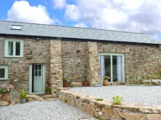 WOODSTONE BARN, barn conversion, woodburner, WiFi, parking, garden, in Tavistock