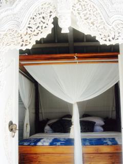 View from the pool onto the four poster bed