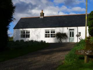 Broomholm Cottage from the front located on a quiet and tranquil private family estate.